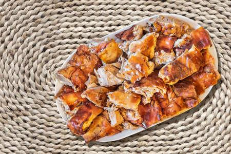 raffia: Plateful of Spit Roasted Pork Slices On Raffia Woven Place Mat