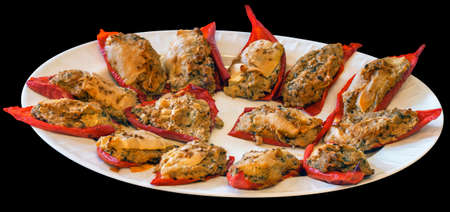 Plateful Of Baked Red Paprika With Courgette Filling Isolated On Black Background