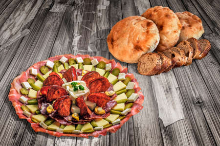 Appetizer Dish Meze With Pita Bread And Integral Baguette Slices On Old Cracked Wooden Surface