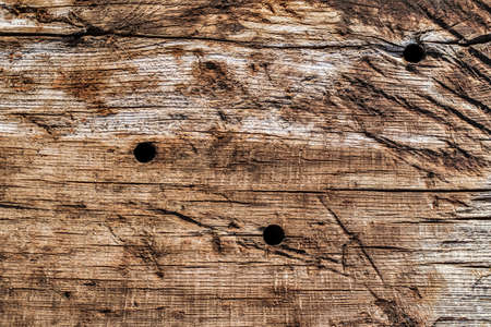 drilled: Old Weathered Rotten Cracked Wood Grunge Texture Stock Photo