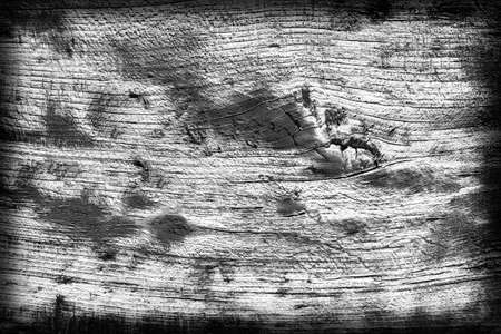 Old Knotted Wood Weathered Rotten Cracked Bleached And Stained Dark Gray Vignetted Grunge Texture