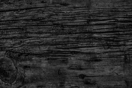 dilapidation: Old Knotted Wood Weathered Rotten Cracked Bleached And Stained Charcoal Black Grunge Texture