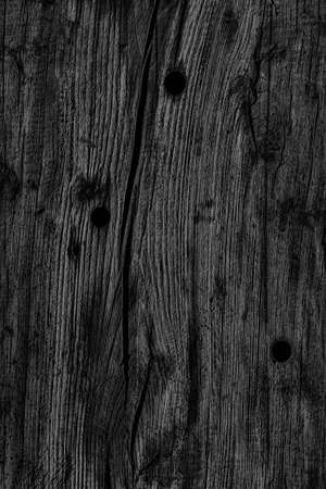bollard: Old Knotted Wood Weathered Rotten Cracked Bleached And Stained Charcoal Black Grunge Texture