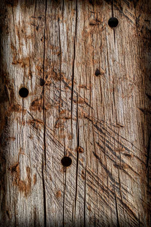 dilapidation: Old Knotted Wood Weathered Rotten Cracked Vignetted Grunge Texture Stock Photo