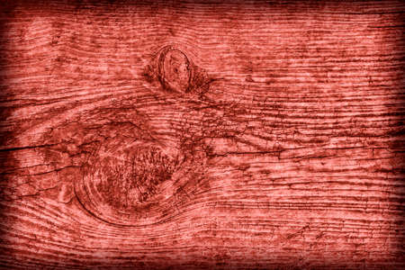 dilapidation: Old Knotted Wood Weathered Rotten Cracked Bleached And Stained Maroon Red Vignetted Grunge Texture Stock Photo