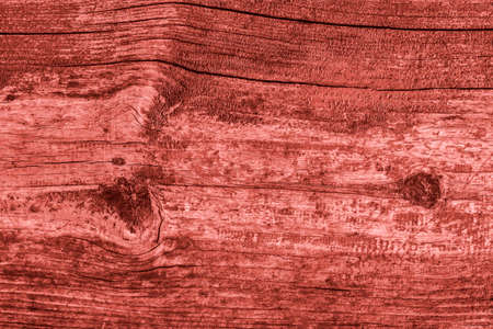 dilapidation: Old Knotted Wood Weathered Rotten Cracked Bleached And Stained Maroon Red Grunge Texture