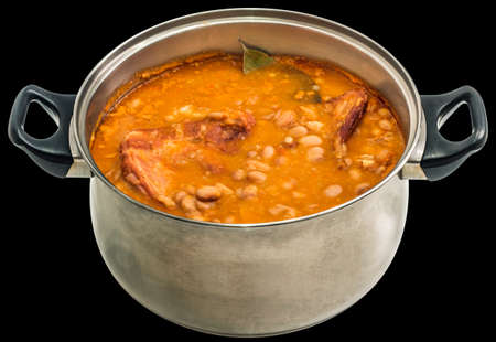 stockpot: Beans With Smoked Pork Ribs Baked In Old Stainless Steel Saucepot Isolated On Black Background