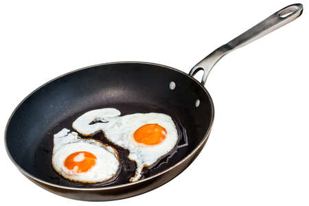 sunny side: Sunny Side Up Eggs Fried In Old Heavy Duty Teflon Frying Pan Isolated On White Background
