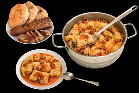 stockpot: Plateful Of Cabbage Rolls Stuffed With Minced Meat Cooked With Smoked Ham Slices In Stainless Steel Saucepot And Pitta Bread Loafs With Sliced Baguette Isolated On Black Background