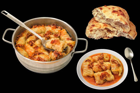 Sauce Pot And Plate Of Cabbage Rolls Stuffed With Minced Meat And Pitta Bread Isolated On Black Background Stock Photo