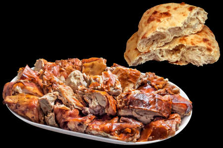 Plateful Of Spit Roasted Pork Slices With Torn Pitta Bread Loaf Isolated On Black Background