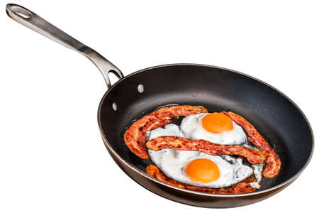 Sunny Side Up Eggs Fried with Bacon Rashers in Old Frying Pan Isolated On White Background Stock Photo