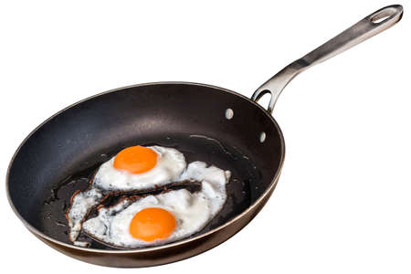sunny side: Sunny Side Up Eggs Fried In Old Heavy Duty Steel Frying Pan Isolated On White Background