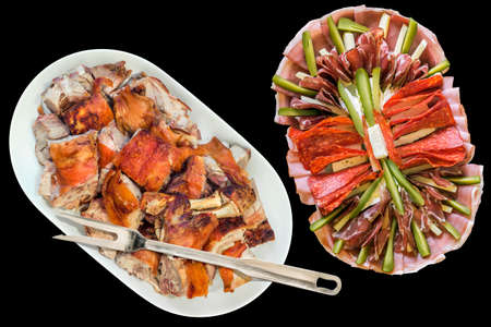 Plateful of Spit Roasted Pork Shoulder Slices and Serbian Appetizer Savory Dish Meze Isolated on Black Background