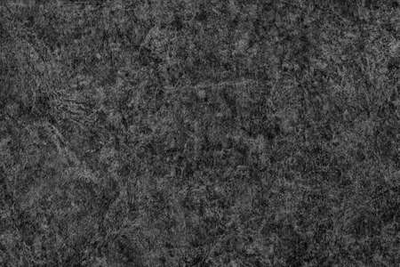 mottled skin: Antique Black Animal Skin Parchment Wizened Coarse Grunge Texture Stock Photo
