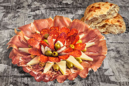 Appetizer Savory Dish Meze and Torn Pitta Bread Loaf Halves Set on Old Weathered Cracked Wooden Garden Table Stock Photo