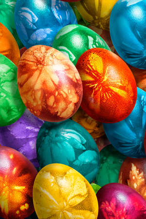 Bunch of Colorful Easter Eggs Decorated with Leaves Imprints Stock Photo