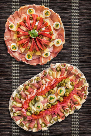welcome mat: Appetizer Savory Dishes Meze Set on Parchment Table Mat Stock Photo
