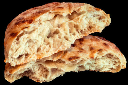 Pitta Bread Torn Loaf Halves Isolated on Black Background