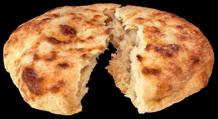 Loaf of Leavened Flatbread Torn in Half Isolated on Black Background Stock Photo
