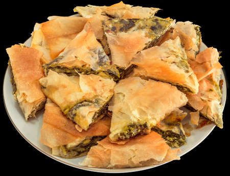 Plateful of Serbian Traditional Cheese Spinach Pie Zeljanica Slices Isolated on Black Background