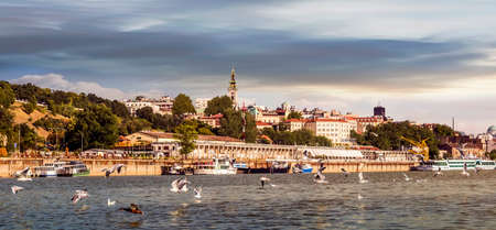 Belgrade Downtown Cloudy Sunset Panorama With Tourist Port Viewed From Sava River Perspective