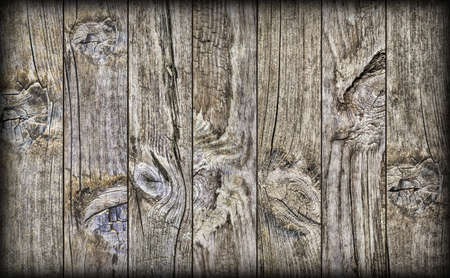 floorboards: Old Weathered Knotted Cracked Rustic Pine Wood Planking Coarse Vignetted Grunge Texture Stock Photo