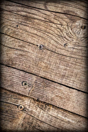Old Weathered Cracked Knotted Coarse Pine Wood Vignette Grunge Surface With Rusty  Screws Embedded Detail