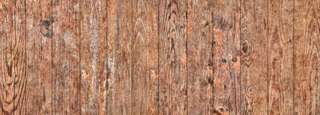 Old weathered cracked knotted Pine wood floorboards grunge texture detail