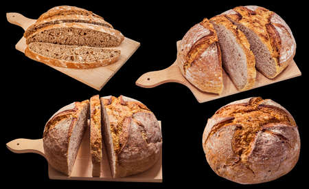 Domestic Dark Multi Grain Bread Loaves Isolated on Black Background Banco de Imagens