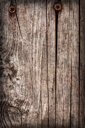 Old Weathered Cracked Knotted Pine Wood Floorboards With Rusty Phillips Screws Embedded Vignette Grunge Texture Detail Stock Photo