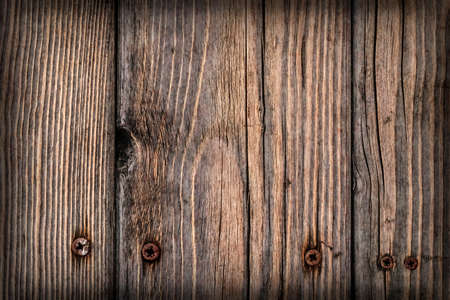 Old Weathered Cracked Knotted Pine Wood Floorboards With Rusty Phillips Screws Embedded Vignette Grunge Texture Detail Standard-Bild