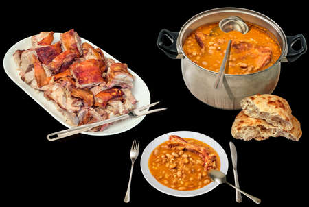 Gourmet Juicy Crunchy Spit Roasted Piglet Meat Chunks Served with Traditional Baked Beans and Pita Leavened Flatbread Loaf Isolated on Black Background