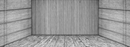 High resolution empty gray grunge scenery with Bamboo mat walls and old knotted Pine wood planked stage Reklamní fotografie