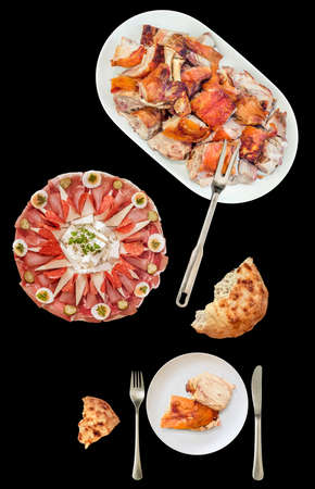 Traditional Garnished Appetizer Savory Dish With Plateful of Spit Roasted Pork Meat Isolated on Black Background