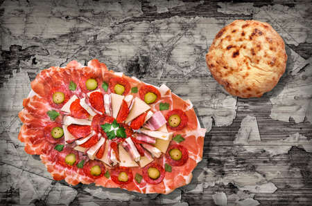 Traditional Appetizer Garnished Gourmet Savory Welcome Dish and Pita Bread Loaf Set on Rustic Old Weathered Cracked Pinewood Vignette Backdrop Imagens