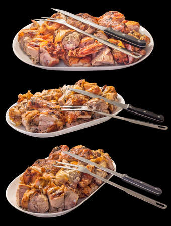 Fresh Spit Roasted Pork Meat Slices Offered on Porcelain Platter With Carving Knife and Serving Fork Side View Isolated on Black Background Stock Photo
