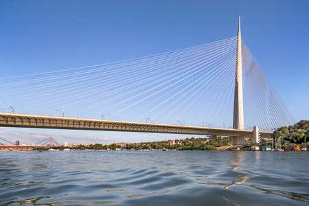 Cable supported, single pylon Ada Bridge, spanning Ada Ciganlija isle and banks of Sava river, in Belgrade, Serbia, Europe. Reklamní fotografie