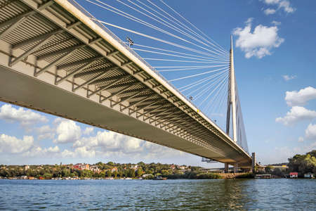 Cable supported, single pylon Ada Bridge, spanning Ada Ciganlija isle and banks of Sava river, in Belgrade, Serbia, Europe.