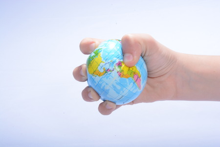 geosphere: hang gripping the globe Stock Photo