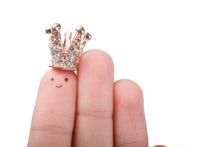 royals: Finger with dots like a face and a crown on the top