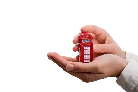 telephone booth: Telephone booth in hand on a white background