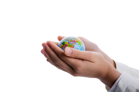 the meridian: Child holding a small globe in hand on white background Stock Photo
