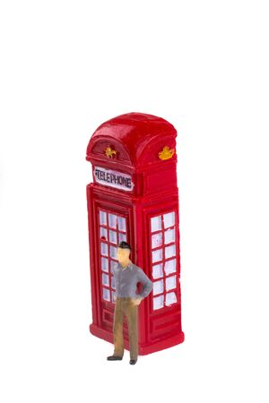 telephone booth: Model man standing by the telephone booth on a white background Stock Photo