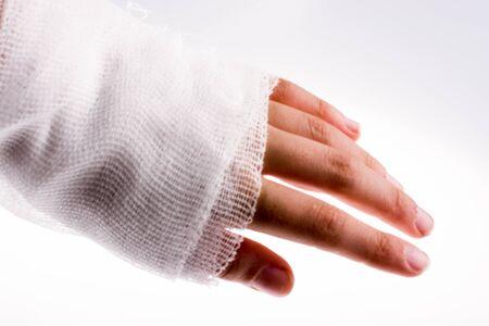 white bandage: hand wrapped in white bandage on a white background