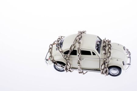 chained: Chained white car on white background