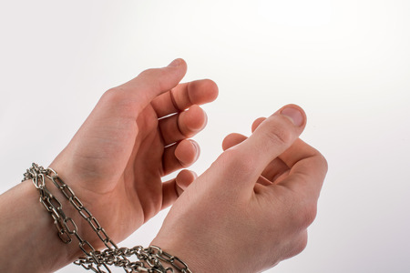 chaining: Hands in chains on a white background