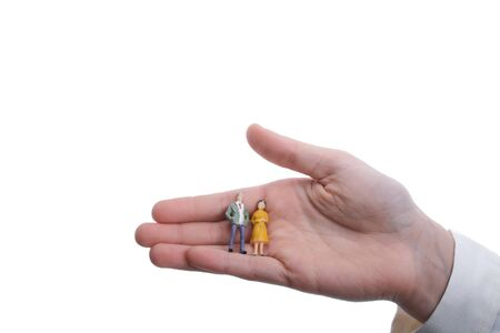 artificial model: figurine model men in hand on a white background