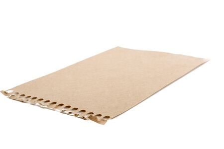 notepaper: Sheet of brown torn notepaper on a white background Stock Photo