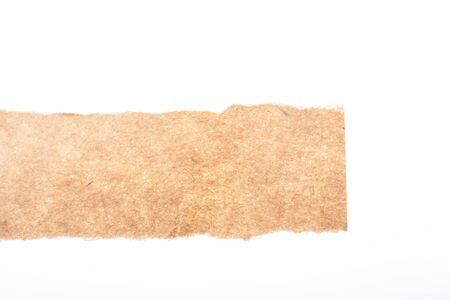 information medium: a piece of brown blank torn note paper